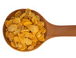 Spoonful of cornflakes isolated over white background