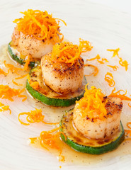 Pan fried scallops with citrus zest