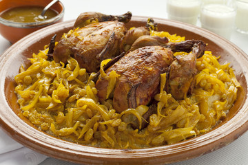 Moroccan couscous with chicken and caramelized Onions
