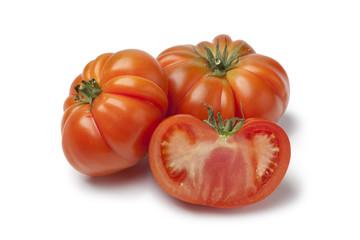 Organic whole and half Coeur de Boeuf tomatoes