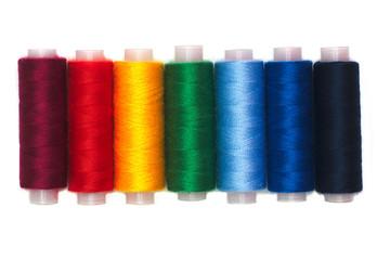 Rainbow colors thread spools isolated