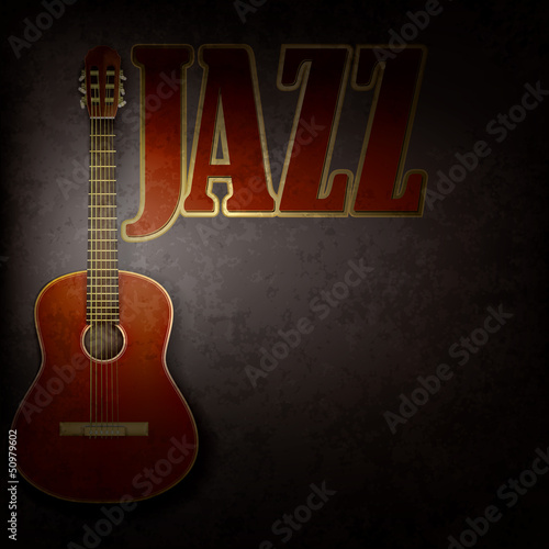 acoustic guitar on gray