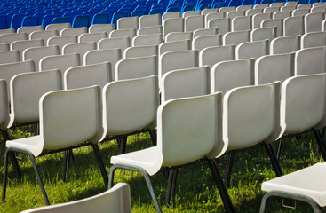 white chairs before a concert