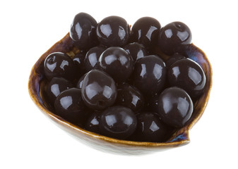 Olives black watered with olive oil in a bowl isolated on a whit