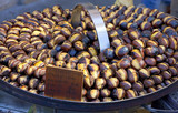Roasting chestnuts on the grill by a street vendor in Rome