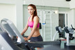 fitness model runs on treadmill, is engaged in fitness club