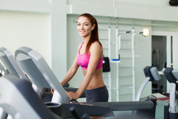 fitness model runs on treadmill is engaged in fitness sport club