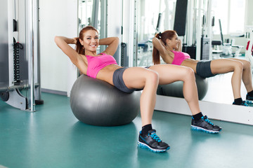 fitness model workout with gymnastic ball in fitness center