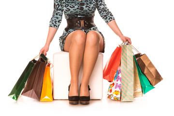 Woman legs in highheels with shopping bags. Shopping concept.