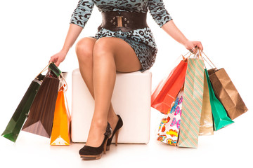 Woman legs in high-heels with shopping bags. Shopping concept.