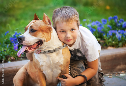 Happy young Boy and his dog