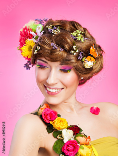 young woman with bright glamour makeup and flowers