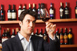 Sommelier examining a glass of red wine