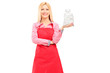 A smiling housewife wearing apron and holding a bag