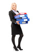 Full length portrait of a young businesswoman carrying folders