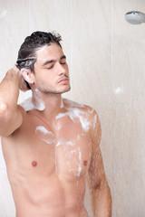 Handsome man in shower