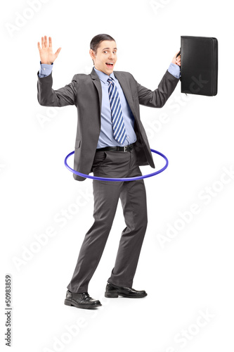 Full length portrait of a businessman in suit holding a briefcas