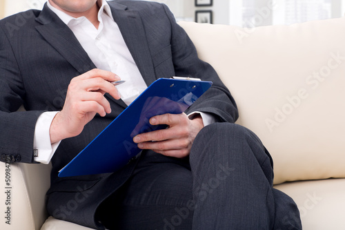 male psychologist  being ready to take notes