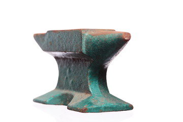 Old rusty green anvil  isolated