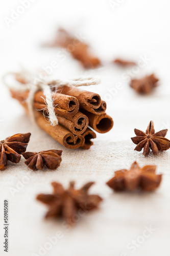 Pile of cinnamon sticks and cloves on homemade canvas