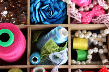 thread and material for handicrafts in box close-up