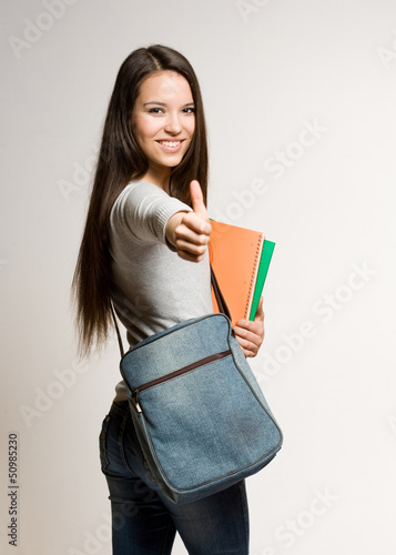 Confident young brunette student.