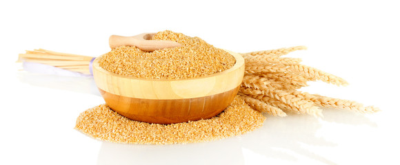 arnautka in wooden bowl with spikelets isolated on white