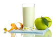Glass of kefir, green apples and measuring tape isolated