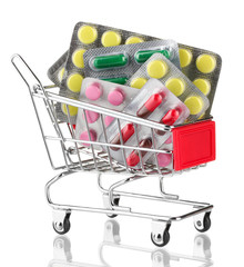 shopping trolley with pills, isolated on white