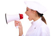 Portrait of young woman chef with megaphone isolated on white