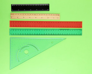 Rulers on green background