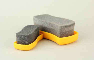 Shoe shine sponges, on color background