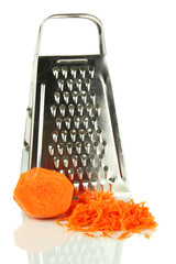 Metal grater and carrot, close up, isolated on white