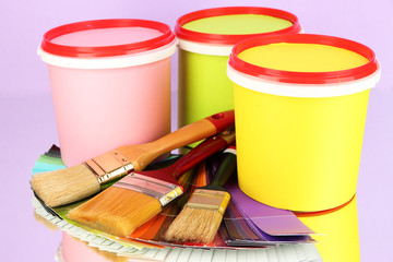 Set for painting: paint pots, brushes, palette of colors