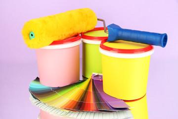 Set for painting: paint pots, paint-roller, palette of colors