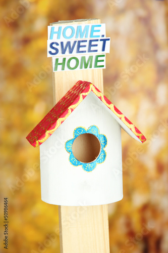 Decorative nesting box and sign on bright background