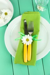 Knife and fork wrapped in napkin,