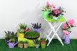 Color crate and table with decorative elements and flowers