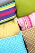 Many various pillows close-up