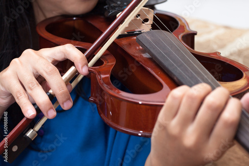 Playing the violin, musical instrument with performer hands