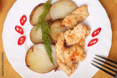 Potato slices with chicken - Top view
