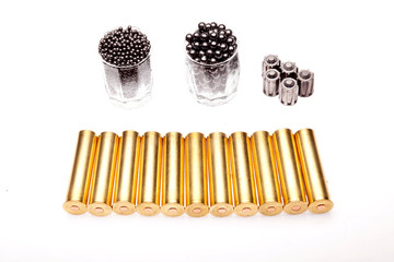 shot and hunting cartridges on a white background