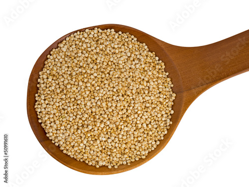 Quinoa on wooden spoon isolated over white background