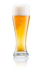 Glass of fresh beer with cap of foam isolated on a white backgro