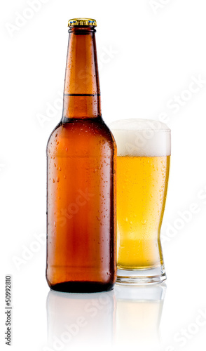 Brown bottle with drops and Glass of beer isolated on a white ba