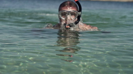 Man snorkeling in the sea, super slow motion, shot at 240fps