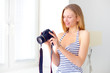 attractive girl with digital camera