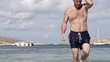Man walking out of the sea, super slow motion, shot at 240fps