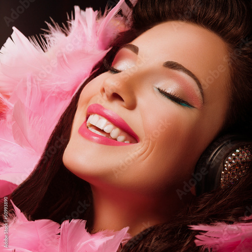 Inspiration. Happy Woman with pink Feathers smiling. Pleasure