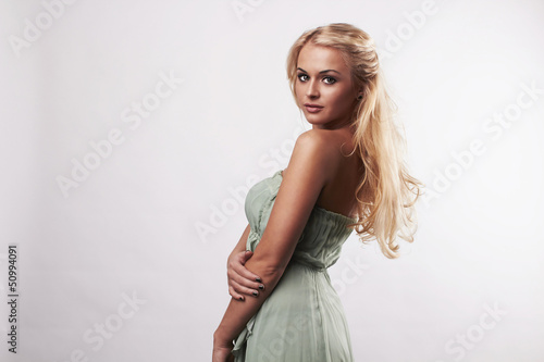 Beautiful cute blond woman in dress